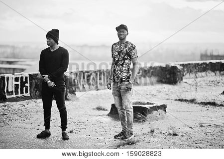 Two gangsta man on the roof. Black and white photo