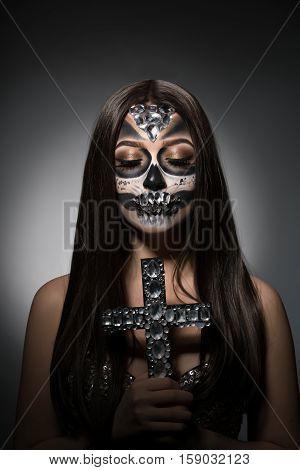 Glamour version of Santa Muerte. Beautiful girl with face art