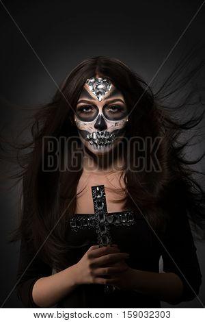 Glamour version of Santa Muerte. Gorgeous model posing