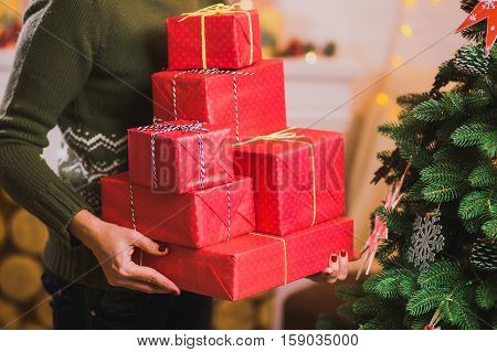 Many Beautiful Present In Red Wrapping Paper