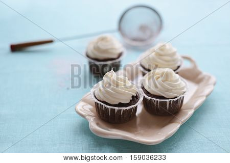 Four cake on a tray and a blue background, close-up