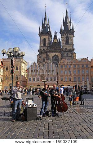 PRAGUE, CZECH REPUBLIC - OCTOBER 4, 2015: street musicians play on Old Town Square Prague Czech Republic