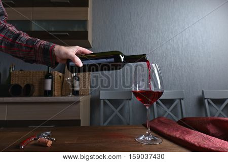 Man Pouring Red Wine Into A Wineglass