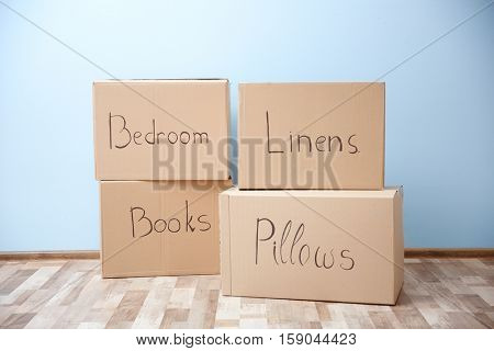 Moving boxes in room on light background