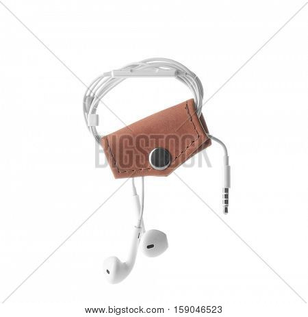 Brown leather earphones holder isolated on white