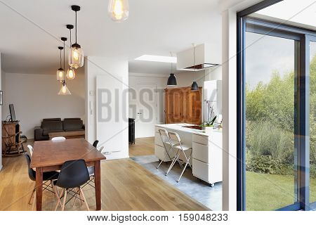 Modern luxury living room and kitchen with view on garden