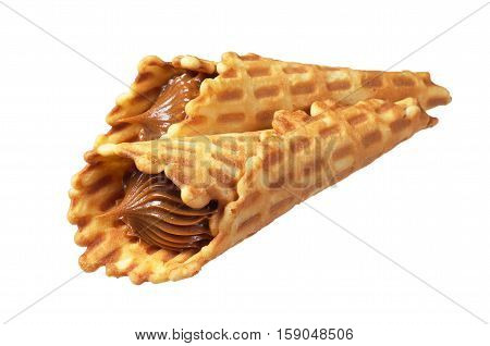Two waffles cones with condensed milk isolated on white background