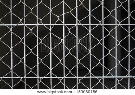 Gray net on grate closeup on black background