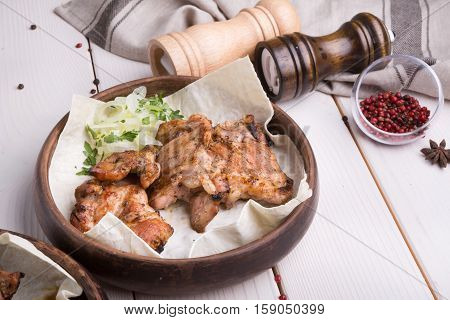 Grilled lamb meat with marinated onion in rustic style