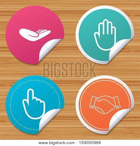 Round stickers or website banners. Hand icons. Handshake successful business symbol. Click here press sign. Human helping donation hand. Circle badges with bended corner. Vector