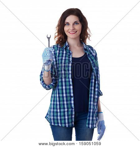 Smiling young woman in casual clothes over white isolated background wrench tool, happy people and construction concept