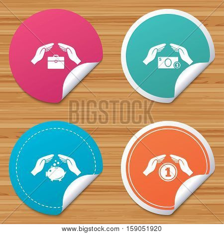 Round stickers or website banners. Hands insurance icons. Piggy bank moneybox symbol. Money savings insurance signs. Travel luggage and cash coin symbols. Circle badges with bended corner. Vector