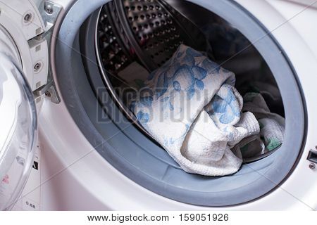 Laundry in the washing machine, towel and linen