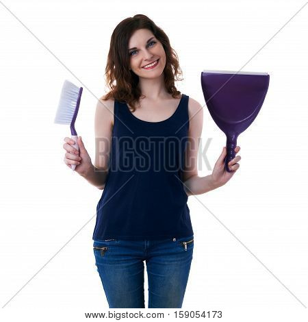 Smiling young woman in dark T-shirt and green rubber gloves over white isolated background holding broom and scoop in hands, cleaning and healthy lifestyle concept