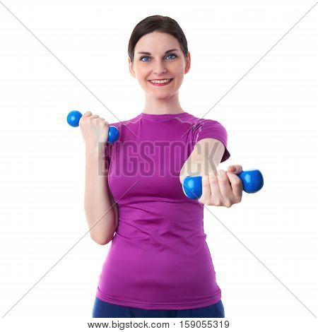 Smiling sporty woman in violet T-short doing exercises with blue dumbbells over white isolated background, fitness, sport and lifestyle concept