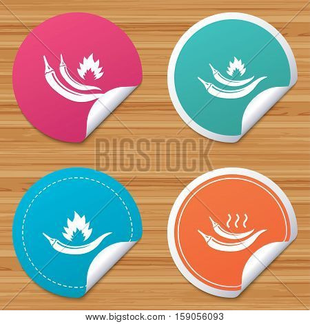 Round stickers or website banners. Hot chili pepper icons. Spicy food fire sign symbols. Circle badges with bended corner. Vector