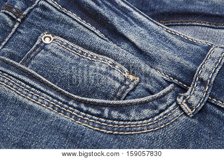 Texture of dark blue jeans close up
