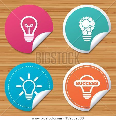 Round stickers or website banners. Light lamp icons. Circles lamp bulb symbols. Energy saving. Idea and success sign. Circle badges with bended corner. Vector
