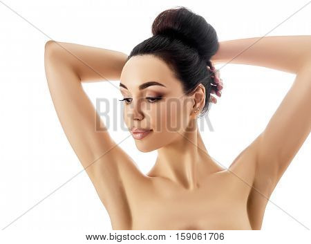 Portrait of beautiful woman. Attractive girl posing at studio over white background with copy space.