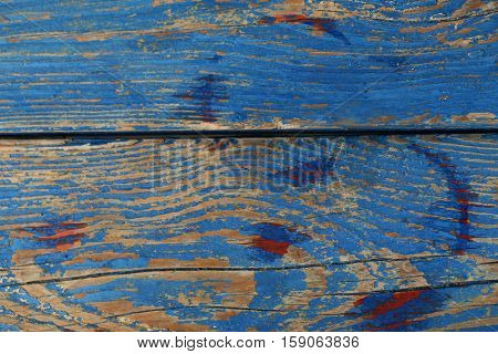 Red wine stains on blue wooden background