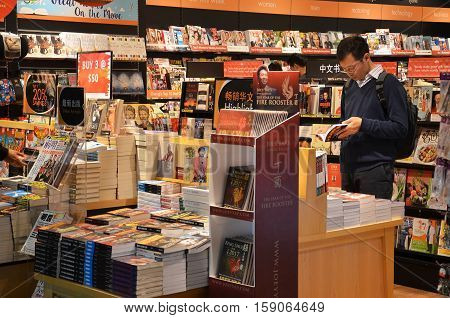 SINGAPORE - 18 NOV 2016: Customers shop for books in Changi Airport Singapore. Singapore airport provides the best shopping experience to the passengers.