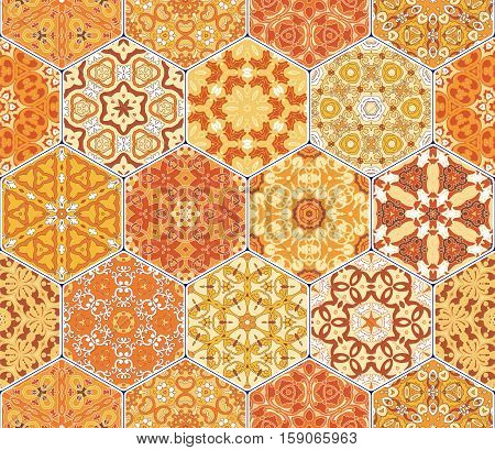 Bright orange seamless pattern tiles. Colorful vector set of hexagonal elements for design of wallpaper, fabric or wrapping paper.
