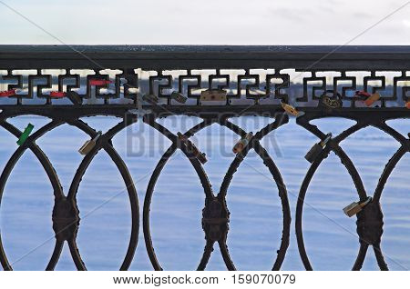 waterfront railing against the background of the winter sky