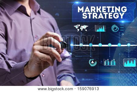Technology, Internet, Business And Marketing. Young Business Man Writing Word: Marketing Strategy
