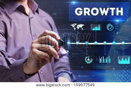 Technology, Internet, Business And Marketing. Young Business Man Writing Word: Growth