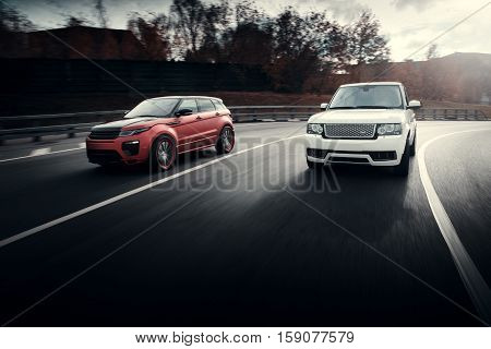 Moscow, Russia - October 23, 2016: Cars Land Rover Range Rover drive on asphalt city road at autumn sunny daytime