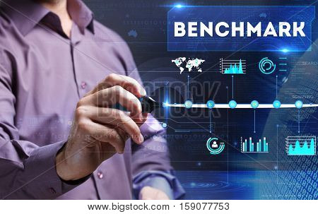 Technology, Internet, Business And Marketing. Young Business Man Writing Word: Benchmark