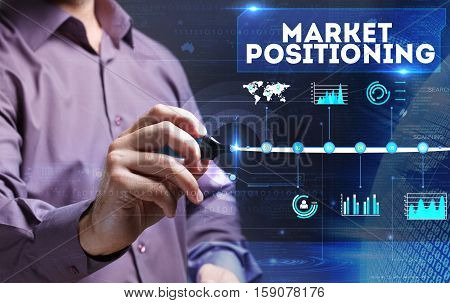 Technology, Internet, Business And Marketing. Young Business Man Writing Word: Market Positioning