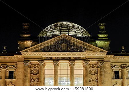 The dome on the roof of the Reichstag in at night  in Berlin, Germany.