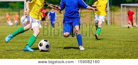Soccer Players Running and Kicking Ball on Sports Field. Young Boys Playing Football Match on Pitch. Youth Football Tournament Competition