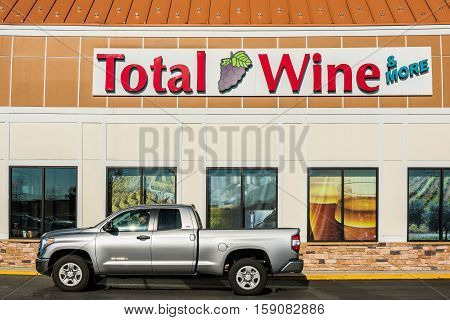 Fairfax, USA - November 27, 2016: Total Wine store in downtown city in Virginia facade with sign, street and car