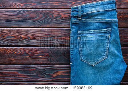 Blue Jeans On A Wooden Background And Space For Text