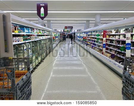 LONDON - NOVEMBER 29: Dairy product aisle at Sainsbury's Supermarket at the O2 Centre Finchley Road on November 29, 2016 in London, UK.