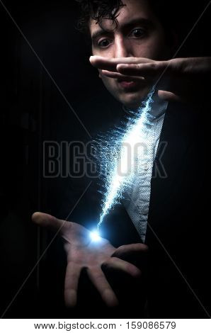 Magician creating sound wave between his hands