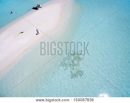 Maldives Island Indian Ocean sandbank, top aerial view. Turquoise water white sandy beach. Travel summer holiday drone selfie concept