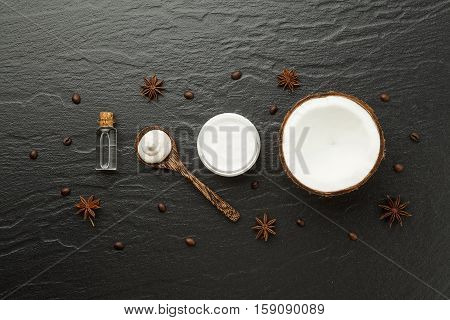 Homemade Spa Products. Half Coconut Shell, Coffee And Anise On Black Background. Oil, Lotion And Scr