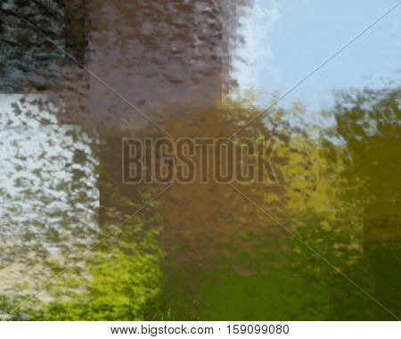 blurred abstract background of colored spots brown green