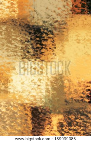 blurred abstract background of colored spots yellow brown