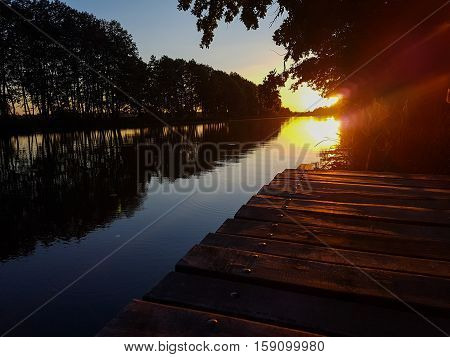 The magnificent sunset on the river. Beauty of nature.