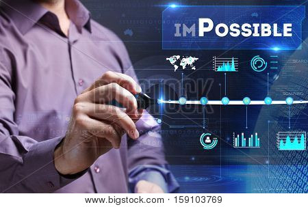 Technology, Internet, Business And Marketing. Young Business Man Writing Word: Impossible