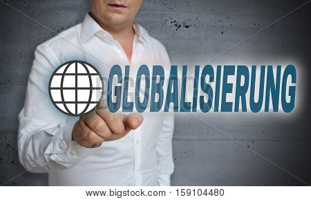 Globalisierung (in german Globalization) touchscreen is operated by man.