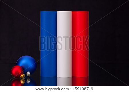 French tricolour and Christmas decoration on the black glass table
