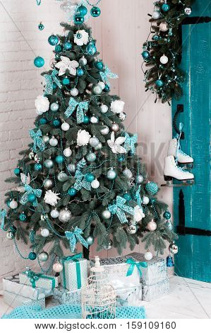 Blue decorative christmas tree with christmas decorations in room over white. Merry christmas. Celebration. Holidays time.