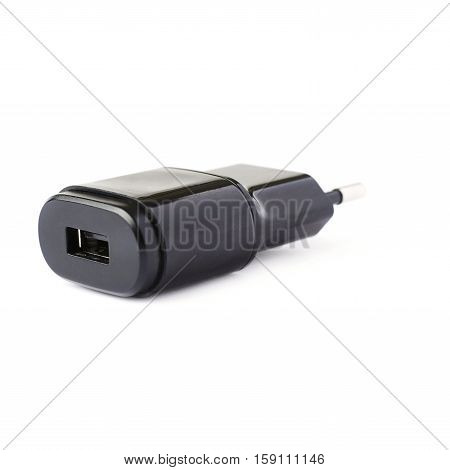 Black usb adapter charger isolated over the white background