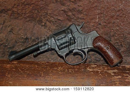 Vintage revolver on the coarse background photo