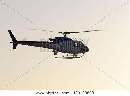 The helicopter flying over Melbourne during the sunrise (Victoria).